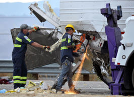 Workers remove wreckage from a semi-truck that crashed with a tour bus on Interstate 10, west of the Indian Canyon Drive off-ramp, in Desert Hot Springs, near Palm Springs, Calif., Sunday, Oct. 23, 2016.
