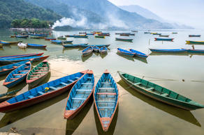 Boats on Nepal's Lake Pokhara, which lies close to three of the world's highest ...