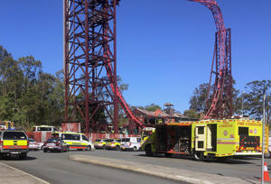 Emergency services vehicles can be seen outside the Dreamworld theme park at Coomera on the Gold Coast, Australia, October 25, 2016 after a number of people were reported killed on a ride at Australia's biggest theme park.