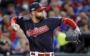 Cleveland Indians starting pitcher Corey Kluber throws against the Toronto Blue Jays during the second inning in Game 1 of baseball's American League Championship Series in Cleveland, Friday, Oct. 14, 2016.
