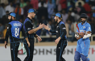 New Zealand's James Neesham, second left, and Kane Williamson celebrate their team's victory over India in the fourth one-day international cricket match in Ranchi, India.