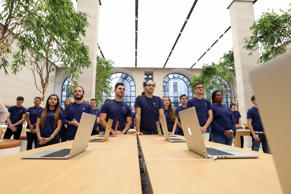 Employees watch speeches at a media event at the newly refurbished Apple Inc. store on Regent Street in London, U.K., on Thursday, Oct. 13, 2016.