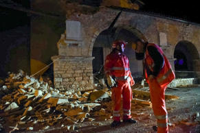 "<span style=""font-size:13px;"">Rescuers stand by rubble in the village of Visso, Italy, on Oct. 26, 2016 following an earthquake. </span>"