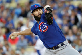 Chicago Cubs' Jake Arrieta throws during the second inning of Game 3 of the National League baseball championship series against the Los Angeles Dodgers Tuesday, Oct. 18, 2016, in Los Angeles.