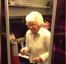 Amazing elderly woman does the paquito and a headstand on French train