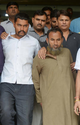 Indian police officials walk with Subhash Jangir (C/L)and Maulana Ramzan (C/R) in New Delhi on October 27, 2016, after they were arrested for alleged espionage activities for South Asian neighbour Pakistan. India has announced that it was expelling a Pakistani visa official for suspected spying after he was briefly detained carrying sensitive defence documents, with tensions between the nuclear-armed neighbours already running high. The official was detained at the Delhi zoo where he had arranged to meet two alleged Indian co-conspirators to exchange information including troop deployment along the border. The two Indian nationals have been charged under the Official Secrets Act and been remanded into custody. One of the men told reporters outside court that he was only 'teaching children'.