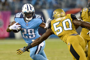 Tennessee Titans running back DeMarco Murray (29) tries to get past Jacksonville Jaguars linebacker Telvin Smith (50) in the first half of an NFL football game Thursday, Oct. 27, 2016, in Nashville, Tenn.