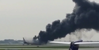 Plane catches fire on Chicago airport runway