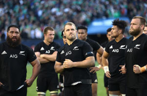 Dejected New Zealand players look on following their team's 40-29 defeat during the international match between Ireland