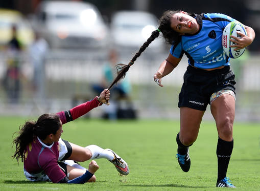 Slide 1 of 80: RIO DE JANEIRO, BRAZIL - MARCH 05: Maryoly Gamez of Venezuela battles for the ball against Victoria Rios of Uruguay during the International Womens Rugby Sevens - Aquece Rio Test Event for the Rio 2016 Olympics at Deodoro Olympic Park on March 6, 2016 in