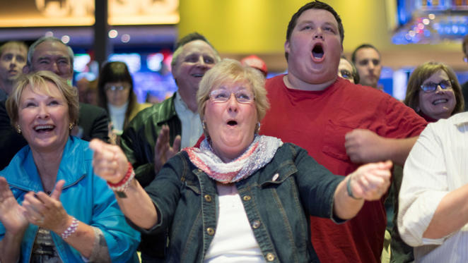 Evelyn McCoy celebrates during the Republican watch party in Oklahoma City, Tuesday, Nov. 8, 2016 as Republican candidate Donald Trump takes another state. (AP Photo/J Pat Carter)