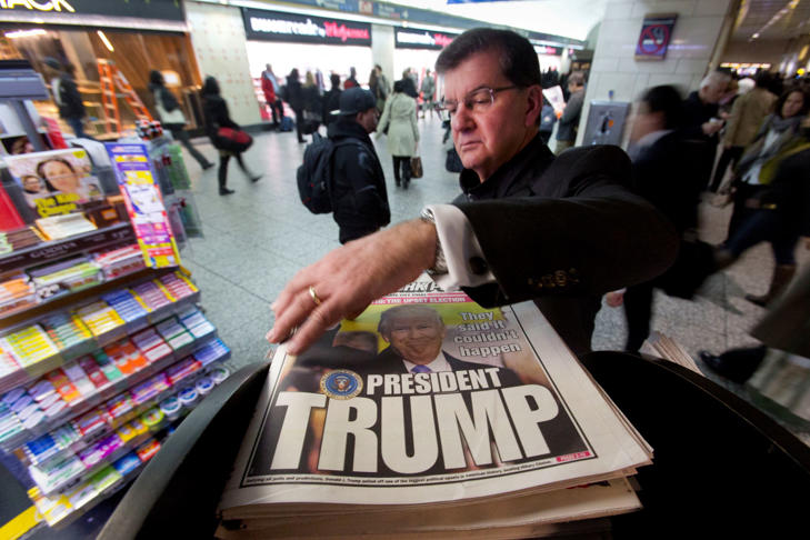 A man reaches for the New York Post newspaper featuring president-elect Donald Trump's victory, Wednesday, Nov. 9, 2016 in New York. Trump claimed his place Wednesday as America's 45th president, an astonishing victory for the celebrity businessman and political novice who capitalized on voters' economic anxieties, took advantage of racial tensions and overcame a string of sexual assault allegations on his way to the White House.
