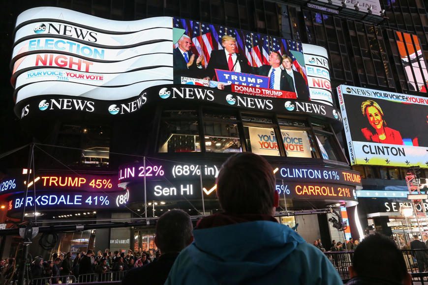 A man watches as Republican president-elect Donald Trump's acceptance speech is broadcast at Times Square Studios after winning the U.S. presidential election in Times Square on November 9, 2016 in New York City. Donald Trump defeated Democratic presidential nominee Hillary Clinton to become the 45th president of the United States.