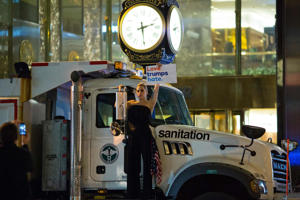 TOPSHOT - Musician Lady Gaga stages a protest against Republican presidential nominee Donald Trump on a sanitation truck outside Trump Tower in New York City after midnight on election day November 9, 2016. Donald Trump stunned America and the world, rid