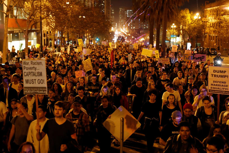 Demonstrators march on Market Street in San Francisco, California, U.S. following the election of Donald Trump as the president of the United States November 9, 2016.