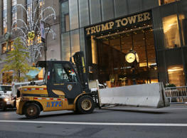 Police officers help to install concrete barriers around Trump Tower, the home of President-elect Donald Trump, in New York, Wednesday, Nov. 9, 2016.