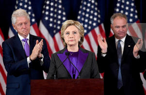 """We owe him an open mind and the chance to lead,"" said Democratic presidential candidate Hillary Clinton (C) at a concession speech, after being defeated by Republican presidential-elect Donald Trump"