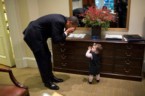 """The President plays peek-a-boo with the daughter of White House staffer Emmett ..."