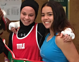 Amaiya Zafar and Aliyah Charbonier share a belt.
