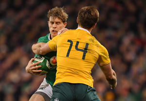 Andrew Trimble gets tackled by Dane Haylett-Petty.