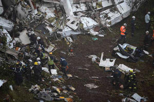 The wreckage of the LAMIA airlines charter plane carrying members of the Chapecoense Real football team is seen after it crashed in the mountains of Cerro Gordo, municipality of La Union, on November 29, 2016. A charter plane carrying the Brazilian footb