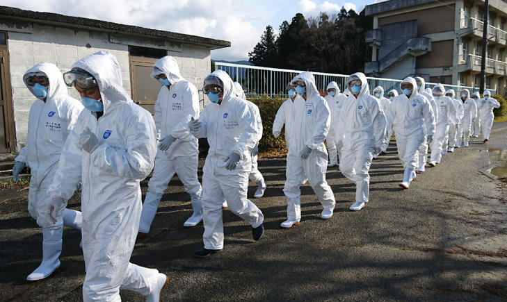 Wearing anti-virus suits, soldiers of the Ground Self Defense Force head for chicken farm in Sekikawa, Niigata prefecture, on November 29, 2016. Japan has begun slaughtering more than 330,000 farm birds to contain its first outbreaks of a highly contagious strain of avian flu in nearly two years.