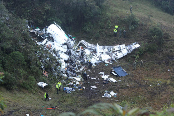 CORRECTS DATE - Police officers and rescue workers search for survivors around the wreckage of a chartered airplane that crashed in La Union, a mountainous area outside Medellin, Colombia, Tuesday, Nov. 29, 2016. The plane was carrying the Brazilian firs