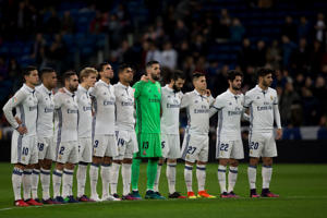 Real Madrid players observe a minute of silence for the victims of a chartered plane carrying the Brazilian soccer team Chapecoense which crashed into the Colombian hillside, prior to their Spain's King's Cup soccer match against Cultural Leonesa, at the