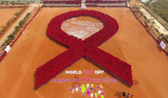 In this aerial photograph made using a drone, students from Indian tribal school, Kalinga Institute of Social Science (KISS) participate in forming a red ribbon, the symbol of HIV/AIDS, in an attempt to make a Guinness Book record on the occasion of Worl