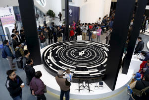 A DJI's Phantom 3 drone flies during a demonstration at their first flagship store in Shenzhen, Guangdong province, China December 20, 2015.