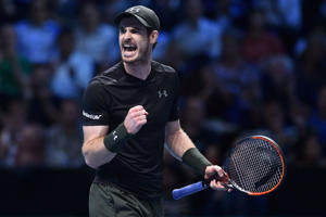 Britain's Andy Murray reacts after winning a point against Croatia's Marin Cilic during their round robin stage men's singles match on day two of the ATP World Tour Finals tennis tournament in London on November 14, 2016.