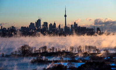 Mist rises from Lake Ontario in front of the Toronto skyline during extreme cold weather on Saturday, Feb. 13, 2016. Environment Canada had issued extreme cold warnings for provinces from Manitoba to New Brunswick