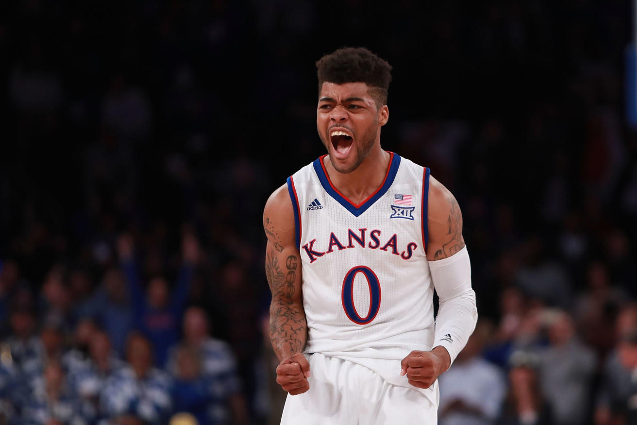Frank Mason III #0 of the Kansas Jayhawks celebrates after hitting a game-winning shot with 1.8 seconds remaining against the Duke Blue Devils in the second half during the State Farm Champions Classic at Madison Square Garden on November 15, 2016 in New York City.