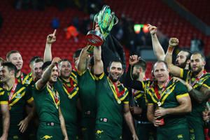 Cameron Smith of Australia lifts the trophy with team mates after victory in the Four Nations Final between New Zealand and Australia at Anfield on November 20, 2016.