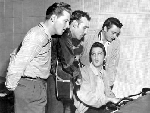 "Rock and roll musicians Jerry Lee Lewis, Carl Perkins, Elvis Presley and Johnny Cash as ""The Million Dollar Quartet"" December 4, 1956 in Memphis, Tennessee. This was a one night jam session at Sun Studios."
