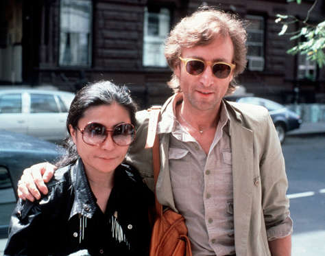 n this Aug. 22, 1980, file photo, John Lennon, right, and his wife, Yoko Ono, arrive at The Hit Factory, a recording studio in New York City. The death of Lennon, shot in 1980 still reverberates as a defining moment for a generation and for the music world.