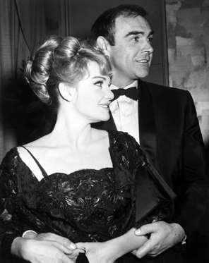 "Diane Cilento and husband Sean Connery, better known to movie fans around the world as ""007"" James Bond. Diane is also an actress and claims she is not the least bit jealous of the exotic femmes her husband woos on-screen, just as long as she is number one offscreen- which she is. Ca. 1970s."