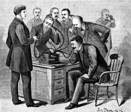 "1877-Illustration of Thomas Edison presenting the first phonograph to the eager editors of ""Scientific American."""