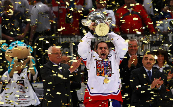 COLOGNE, GERMANY - MAY 23:  Tomas Rolinek (C) of Czech Republic celebrates after winning the IIHF World Championship gold medal match between Russia and Czech Republic at Lanxess Arena on May 23, 2010 in Cologne, Germany.  (Photo by Martin Rose/Bongarts/