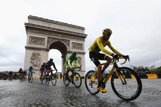 PARIS, FRANCE - JULY 26:  Chris Froome (yellow jersey) of Great Britain and Team Sky rides past the Arc de Triomphe on his way to overall victory during the twenty first stage of the 2015 Tour de France, a 109.5 km stage between Sevres and Paris Champs-E