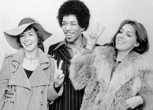 Rock star Jimi Hendrix is acquitted of drug possession charges. His female friends give the peace sign.