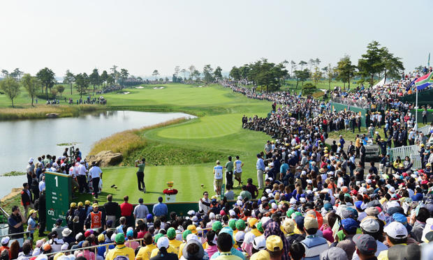 INCHEON CITY, SOUTH KOREA - OCTOBER 08:  Adam Scott of Australia and the International Team hits the first shot of the Thursday foursomes matches on the first hole at The Presidents Cup at Jack Nicklaus Golf Club Korea on October 8, 2015 in Songdo IBD, I