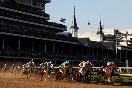 LOUISVILLE, KY - MAY 02:  The field races through turn one at the start of the 141st running of the Kentucky Derby at Churchill Downs on May 2, 2015 in Louisville, Kentucky.  (Photo by Chris Graythen/Getty Images)