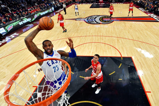 TORONTO, ON - FEBRUARY 14: LeBron James #23 of the Cleveland Cavaliers and the Eastern Conference goes up for a dunk in the first half against Stephen Curry #30 of the Golden State Warriors and the Western Conference during the NBA All-Star Game 2016 at