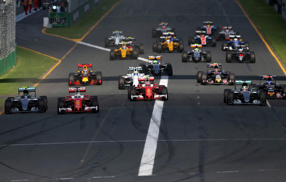 MELBOURNE, AUSTRALIA - MARCH 20:  Sebastian Vettel of Germany and Ferrari leads Nico Rosberg of Germany and Mercedes GP, Kimi Raikkonen of Finland and Ferrari and Lewis Hamilton of Great Britain and Mercedes GP into the first corner during the Australian