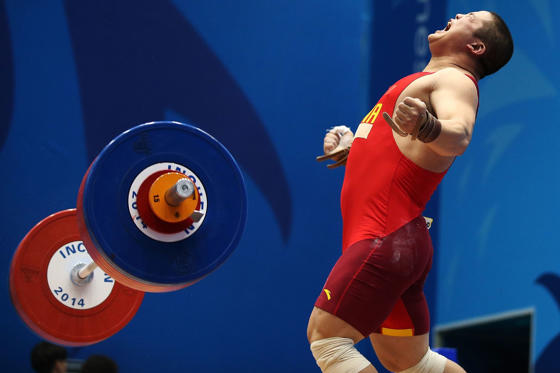 INCHEON, SOUTH KOREA - SEPTEMBER 25:  Hao Lui of China celebrates in the Men's 94kg Weightlifting Final during day six of the 2014 Asian Games at Moonlight Festival Garden Weightlifting Venue on September 25, 2014 in Incheon, South Korea.  (Photo by Bren