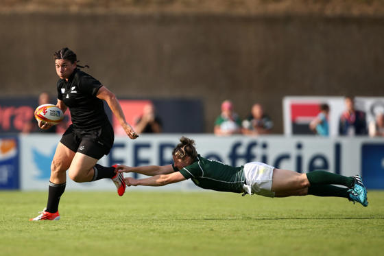 PARIS, FRANCE - AUGUST 05:  Rawinia Everitt of New Zealand evades a tackle by Alison Miller of Ireland during the IRB Women's Rugby World Cup Pool B match between New Zealand and Ireland at the French Rugby Federation headquarters on August 5, 2014 in Pa