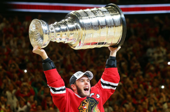 CHICAGO, IL - JUNE 15:  Jonathan Toews #19 of the Chicago Blackhawks celebrates by hoisting the Stanley Cup after defeating the Tampa Bay Lightning  by a score of 2-0 in Game Six to win the 2015 NHL Stanley Cup Final at the United Center  on June 15, 201