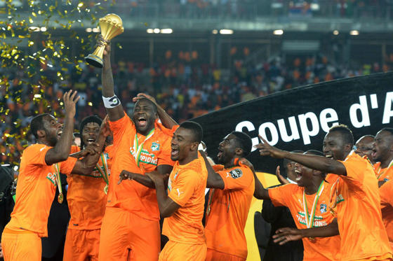 Ivory Coast's midfielder Yaya Toure (3rdL) raises the trophy at the end of the 2015 African Cup of Nations final football match between Ivory Coast and Ghana in Bata on February 8, 2015. Ivory Coast won 9 to 8 on penalties.  AFP PHOTO / KHALED DESOUKI