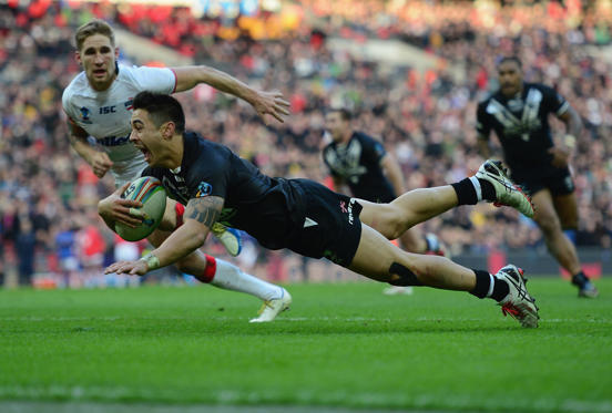 LONDON, ENGLAND - NOVEMBER 23:  Shaun Johnson of New Zealand scores the winning try during the Rugby League World Cup Semi Final match between New Zealand and England at Wembley Stadium on November 23, 2013 in London, England.  (Photo by Jamie McDonald/G